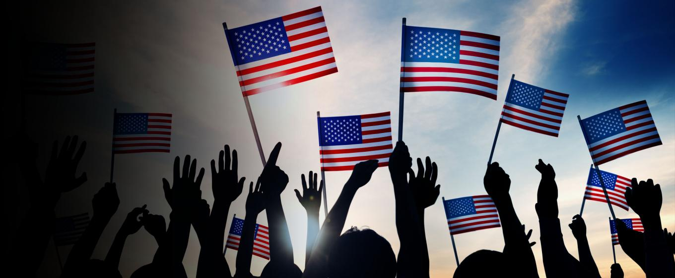 People waving American flags.
